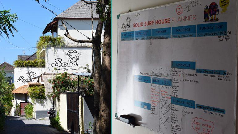 solid surfhouse canggu aussenansicht und whiteboard für organisation der surfkurse
